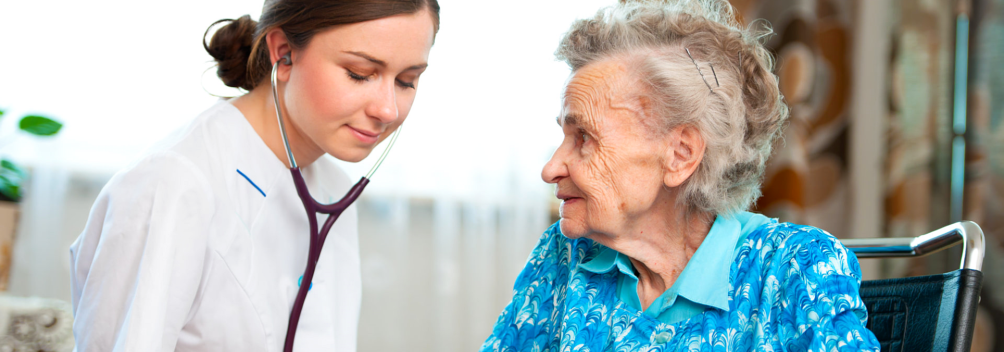 a nurse with a stethoscope and an old woman